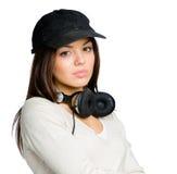 Adolescente en casquillo enarbolado con los auriculares Imágenes de archivo libres de regalías