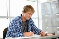 Adolescente en clase Imagenes de archivo