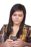 Adolescente en cuestión Texting Foto de archivo libre de regalías