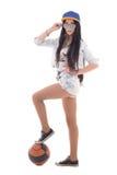 Adolescente en dril de algodón con la bola sobre blanco Imágenes de archivo libres de regalías