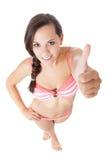 Adolescente en el bikini que muestra los pulgares para arriba Fotos de archivo libres de regalías