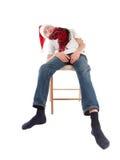 Adolescente en el casquillo de Papá Noel Fotografía de archivo