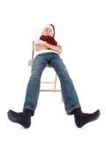 Adolescente en el casquillo de Papá Noel Imagenes de archivo