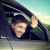 Adolescente en el coche Imagenes de archivo