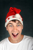 Adolescente en el sombrero de Santas Imagenes de archivo