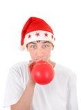 Adolescente en el sombrero de Santas Foto de archivo libre de regalías