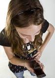Adolescente en el teléfono celular Imágenes de archivo libres de regalías