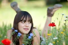 Adolescente en flores Imagen de archivo libre de regalías