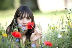 Adolescente en flores Fotos de archivo