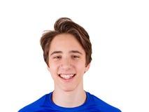 Adolescente en la camiseta azul, aislada en el fondo blanco Fotos de archivo libres de regalías
