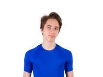 Adolescente en la camiseta azul, aislada en el fondo blanco Imagenes de archivo