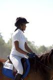 Adolescente en la competición del caballo Imagenes de archivo