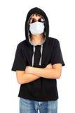 Adolescente en la máscara Foto de archivo