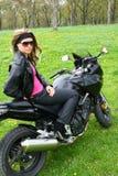 Adolescente en la moto Foto de archivo libre de regalías