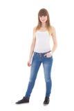 Adolescente en la presentación blanca de la camiseta aislado en blanco Imagenes de archivo