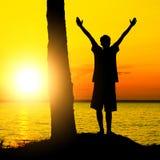Adolescente en la puesta del sol Imagen de archivo