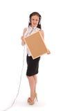 Adolescente en los auriculares, llevando a cabo el tablero del corcho Fotos de archivo