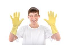 Adolescente en los guantes de goma Foto de archivo