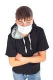 Adolescente en máscara Imagen de archivo