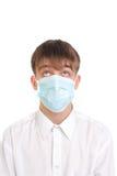 Adolescente en máscara Imagen de archivo libre de regalías