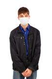 Adolescente en máscara de la gripe Imagen de archivo libre de regalías