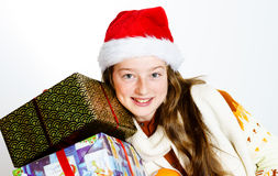 Adolescente en retrato rojo de la Navidad del sombrero de santa Fotos de archivo libres de regalías