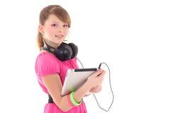 Adolescente en rojo con PC de la tablilla Fotos de archivo