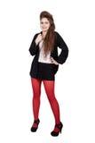 Adolescente en ropa negra y roja Imagenes de archivo