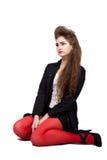 Adolescente en ropa negra y roja Imagen de archivo libre de regalías
