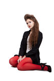 Adolescente en ropa negra y roja Foto de archivo libre de regalías