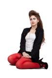 Adolescente en ropa negra y roja Fotografía de archivo libre de regalías
