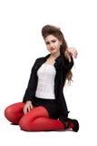 Adolescente en ropa negra y roja Fotografía de archivo