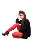 Adolescente en ropa negra y roja Fotos de archivo libres de regalías