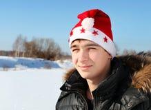 Adolescente en Santa Hat Fotografía de archivo libre de regalías