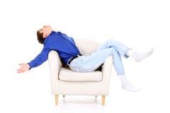 Adolescente en silla Fotos de archivo