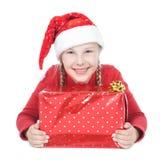 Adolescente en sombrero del ayudante de santa con el regalo Fotos de archivo libres de regalías