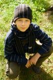 Adolescente en un casquillo Imagen de archivo
