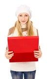 Adolescente en un casquillo del invierno Imagen de archivo