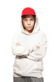 Adolescente en un casquillo y una ropa de deportes rojos Foto de archivo