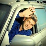 Adolescente en un coche Foto de archivo