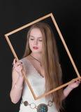 Adolescente en un marco Fotos de archivo
