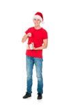 Adolescente en un sombrero de la Navidad y una camisa roja Imagen de archivo libre de regalías
