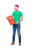 Adolescente en un sombrero de la Navidad y una camisa verde Imagen de archivo libre de regalías