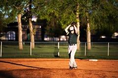 Adolescente en un uniforme del béisbol Fotografía de archivo