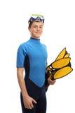 Adolescente en un wetsuit con el equipo que bucea Foto de archivo