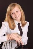 Adolescente en una camisa blanca Foto de archivo libre de regalías