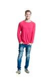 Adolescente en una camisa rosada y vaqueros Imágenes de archivo libres de regalías