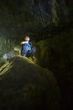 Adolescente en una cueva Foto de archivo libre de regalías