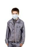 Adolescente en una máscara protectora Imagenes de archivo