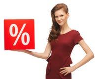Adolescente en vestido rojo con la muestra de la venta Foto de archivo libre de regalías